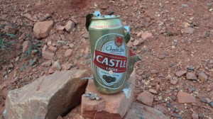 "The can was filled with loose sand. Bullet hole just below the word ""Lager""."